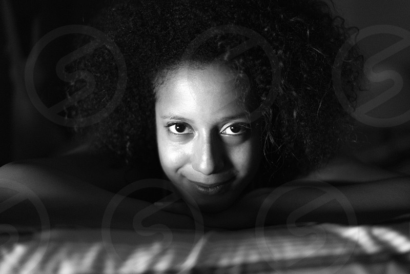 Young black woman portrait under dramatic lighting. photo