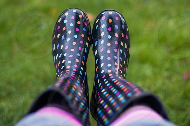 colourful polka dot wellies on grass photo