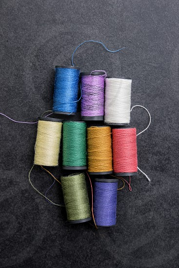 Several spools of colorful thread from above photo