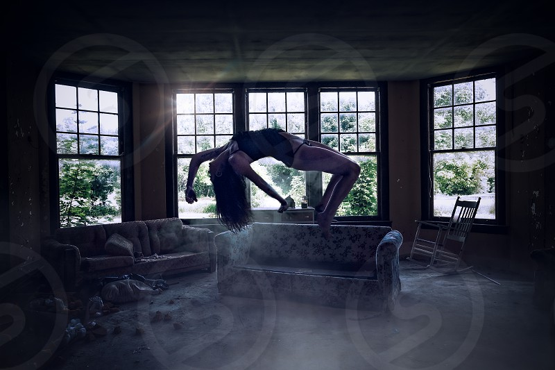 Special effects photo of a model levitating in an abandoned building.  photo