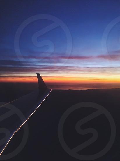 airplane wing sunset photo photo