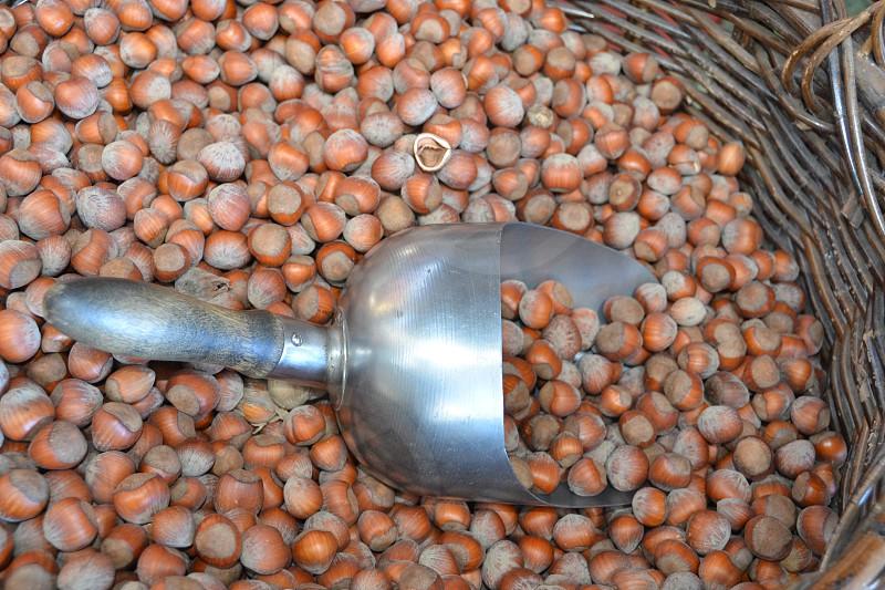 Hazelnuts Filberts metal scoop woven basket nuts photo