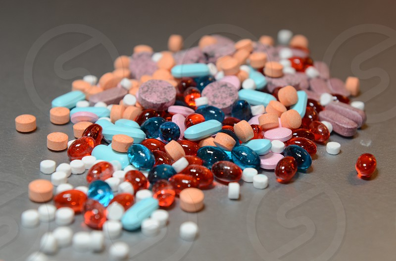 Pile of colorful pills vitamins supplements pharmacy photo
