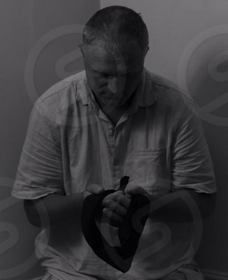 man holding black blind fold photo