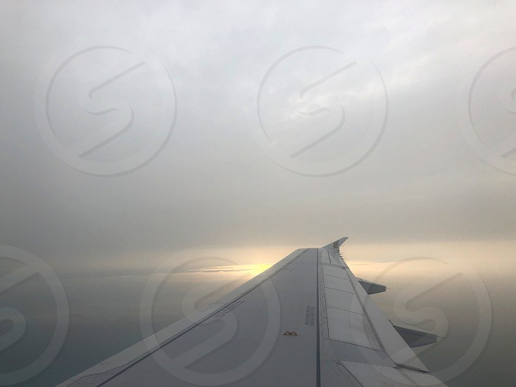 Feeling of flight.Thousands of kilometers above the clouds. View from the window of the plane. Blue white and incomprehensible sky. photo