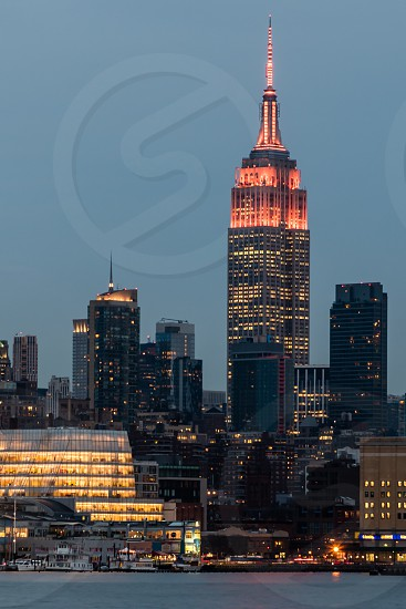 high rise building with red lighting during nigh time photo