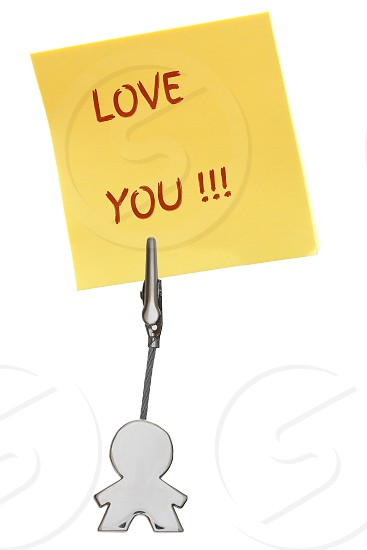 Love you note written on yellow post it note held by man figure with clip photo