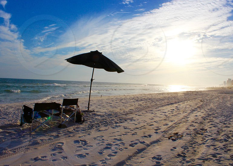 Umbrella sitting on a beach photo