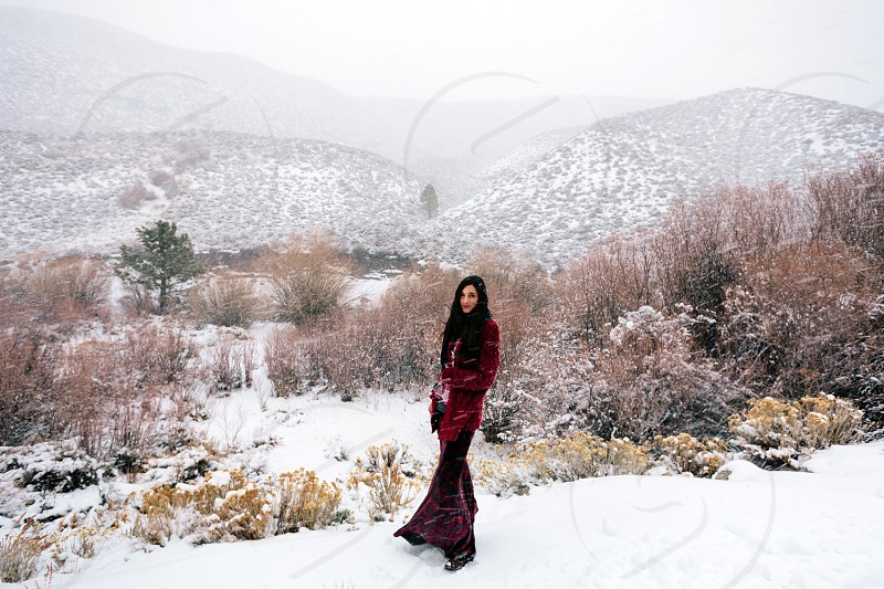 wearing red in a winter storm photo