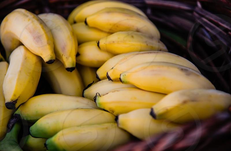 yellow banana in brown woven basket photo