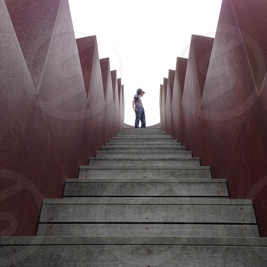 man standing on top of stairs photo