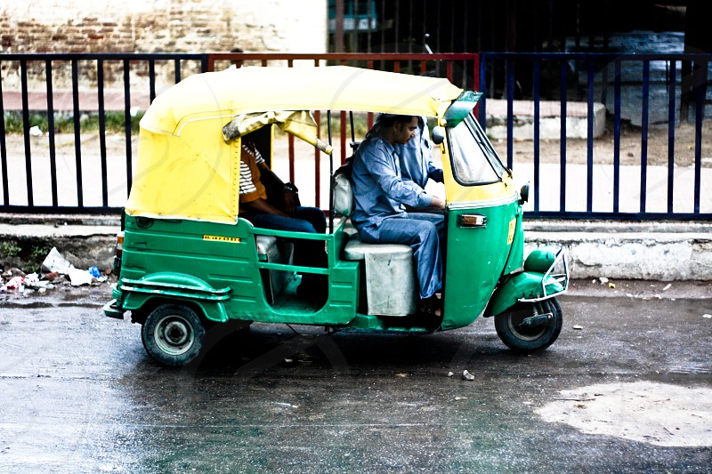 person inside tricycle photo