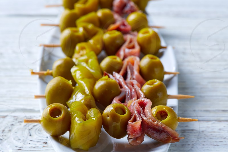 Gilda pinchos with olives and anchovies tapas from Spain photo