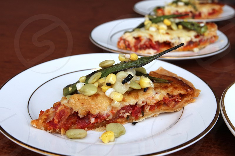Slices of gourmet pizza photo