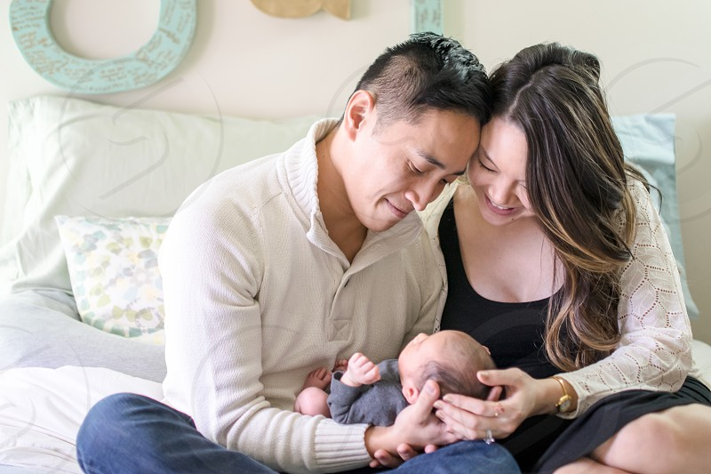 First time parents falling completely in love with their newborn photo