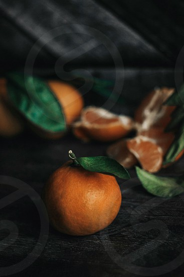 mandarin slices tangerines on a wooden background fruits orange fruits still life photo