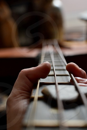 Playing a string instrument photo