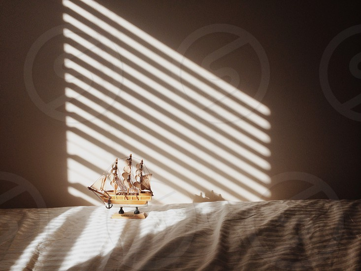 brown galleon ship figure on bed photo
