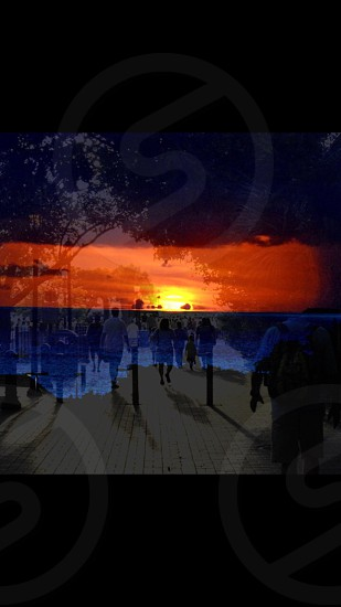 The sunset was taken in Key West Florida from the top of a hotel and the people walking are also from KWF.  photo