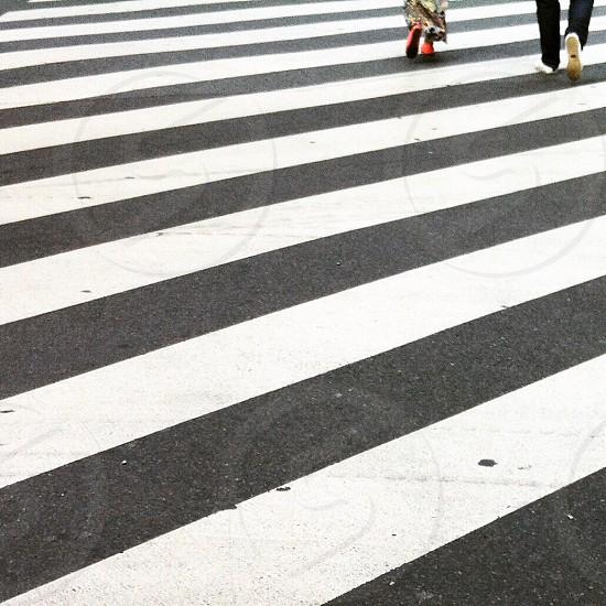 2 people crossing the pedestrian lane photo