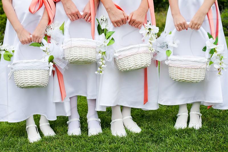Flower girls with flower baskets  photo