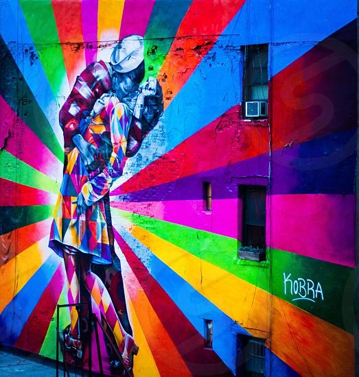 KOBRA rainbow graffiti art of embracing sailor and woman photo