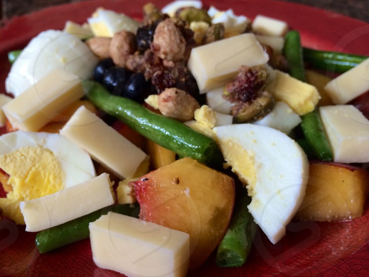 Crispy String Bean Salad with Fruit Hard Boiled Egg Pomegranate Pistachio with Almonds Cherries + Black Pepper Topped with Canadian Cheddar Cheese  photo