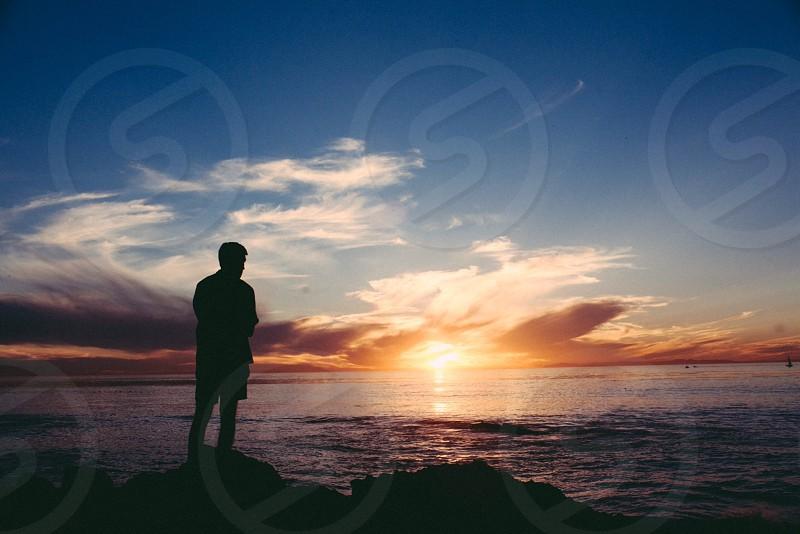 man standing silhouette photo