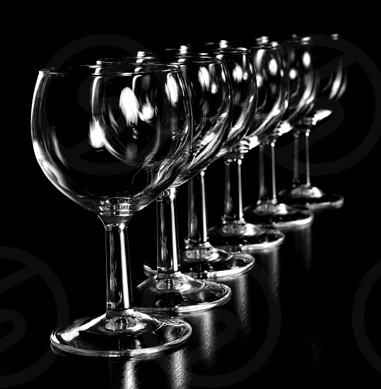 Wine glasses on a black background  photo