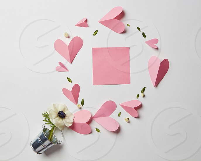 flowers in a bucket paper hearts and blank valentine card with copy-space to write your own text. photo