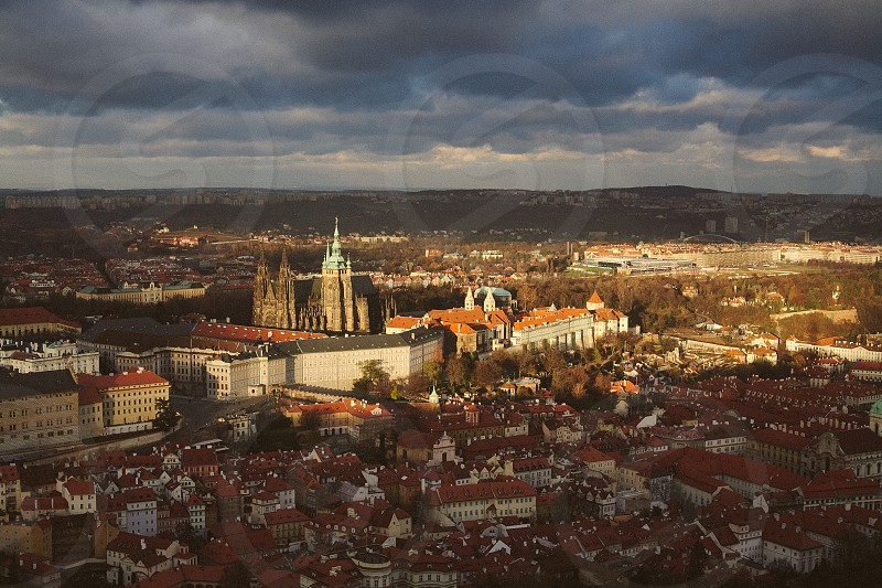 View of the Prague Castle from the Petřín Lookout Tower during a stormy cloudy day. photo
