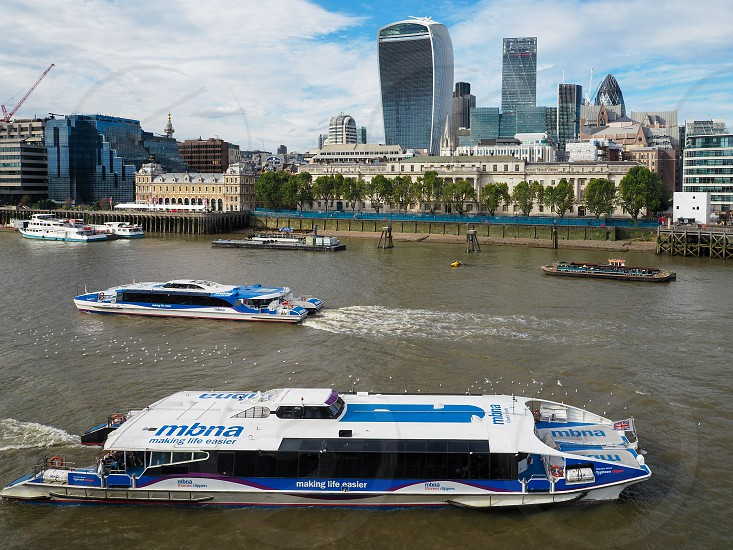 River Buses Cruising along the River Thames photo
