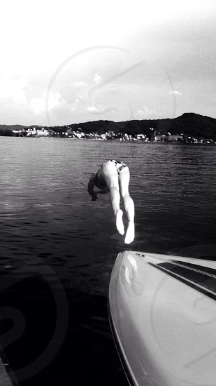 woman diving into the water photo