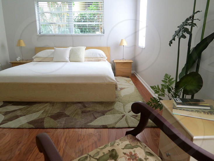Bedroom neutral colors cream white gray beige burgundy wooden floor abstract foliage rug contemporary style photo