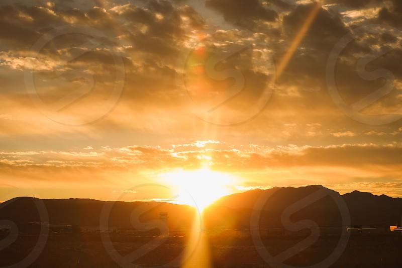 sunsettwilightraymountainsunrisegolden hourmagic hourcloudsskyorangelandscapesceneryscenic photo