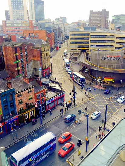 Cityscape. Manchester United Kingdom. Architecture buildings roads traffic looking down. photo