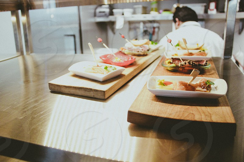 food dishes being served in the counter photo