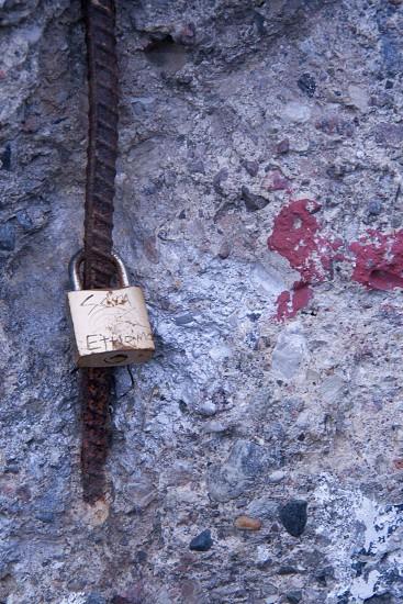 grey padlock on brown metal bar photo