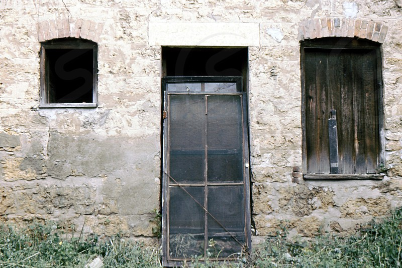 Surviving door with windows that don't match. Nevada CO USA. 1972. photo