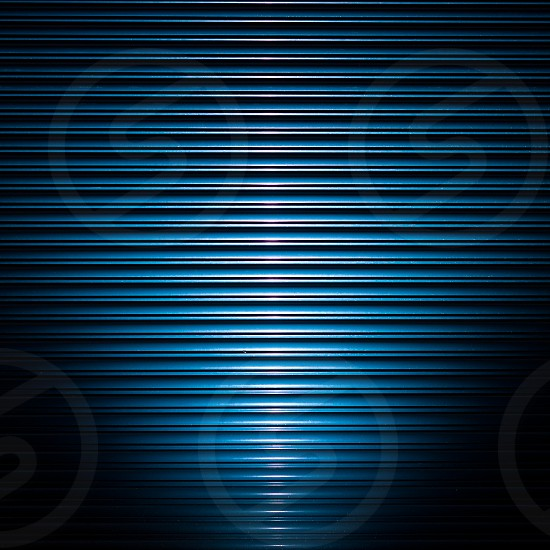 Industrial blue roller shutter door lit from below by a blue-gelled strobe. photo