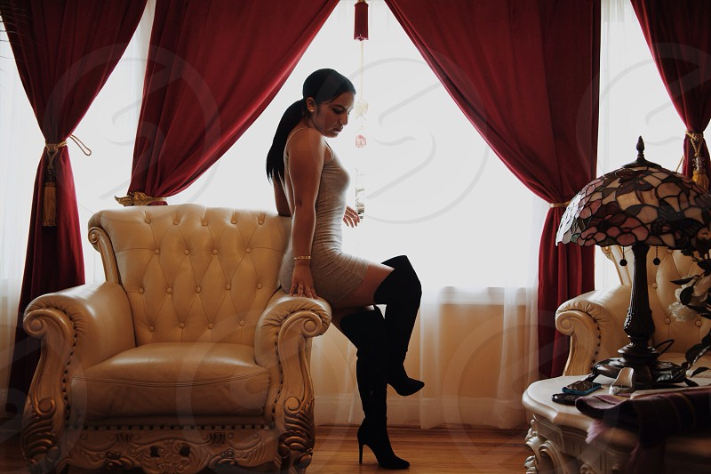 woman wearing black knee high boots photo