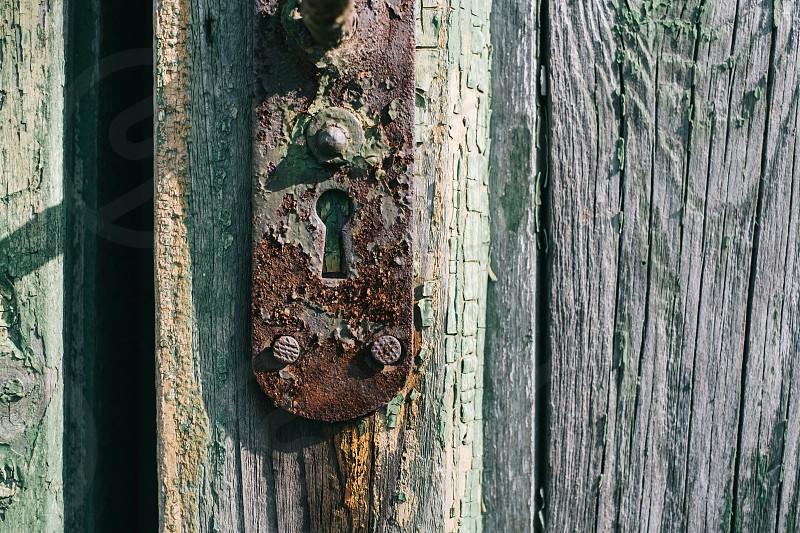 Lock in a green door photo