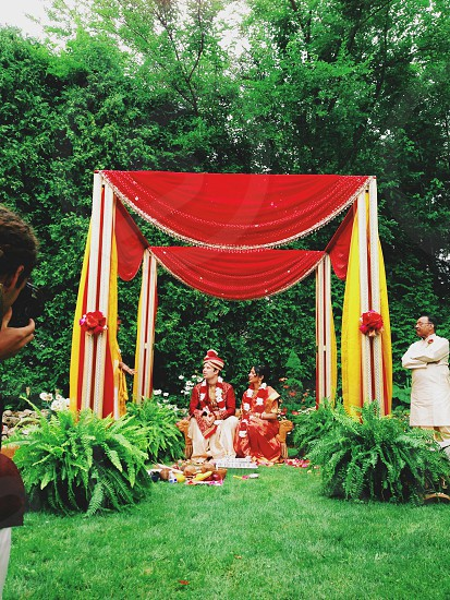 man and woman in ceremony photo