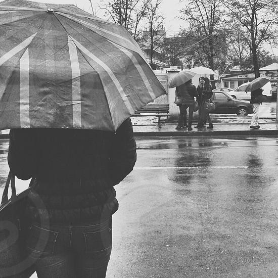 girl rain umbrella black and white street photo