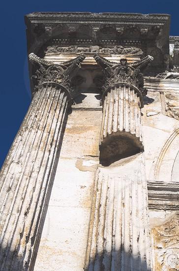 Ancient Roman White Ornate Pillar Architecture Closeup photo