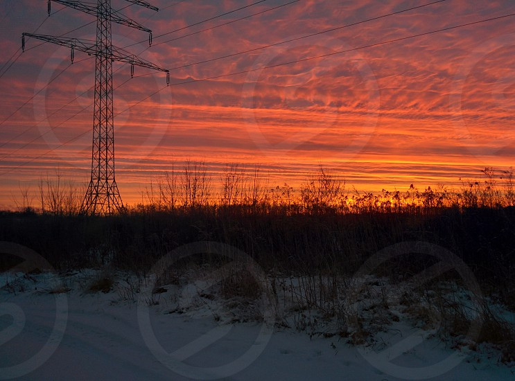 Sundusk over the city emty field photo