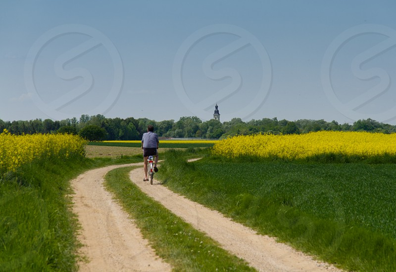 man biking on road way with grass view photo