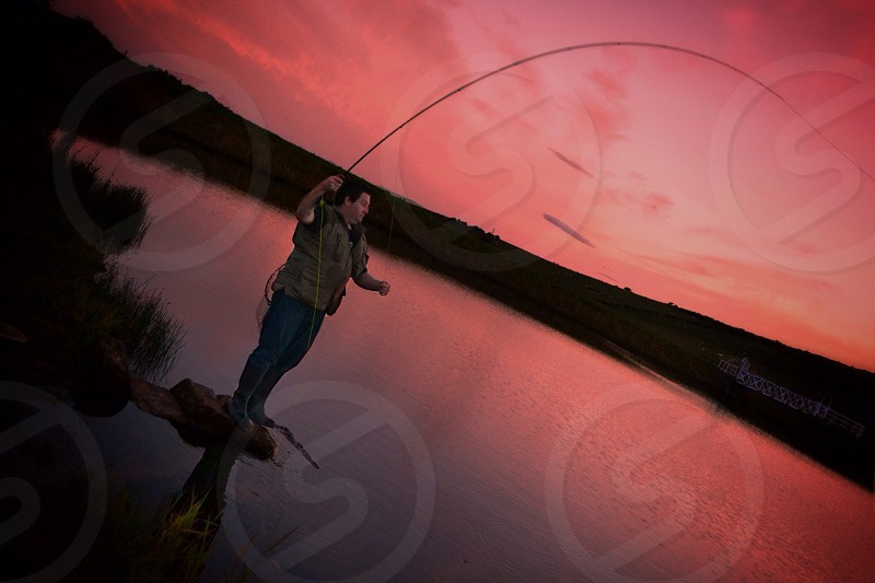 Fishing while sunset  photo