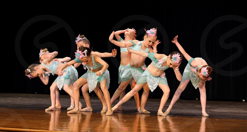 Dancers girl kids child daughter children lyrical ballet stage performance costume pose sweet competition team photo