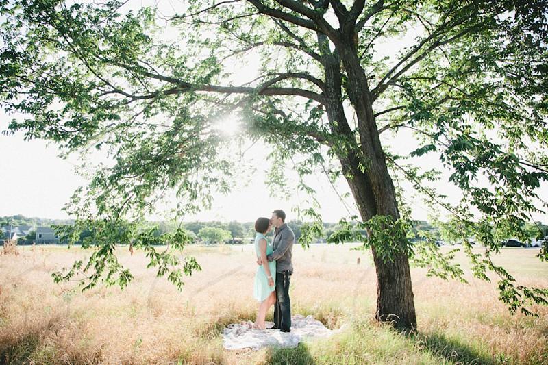two people beside tree on grass field photo